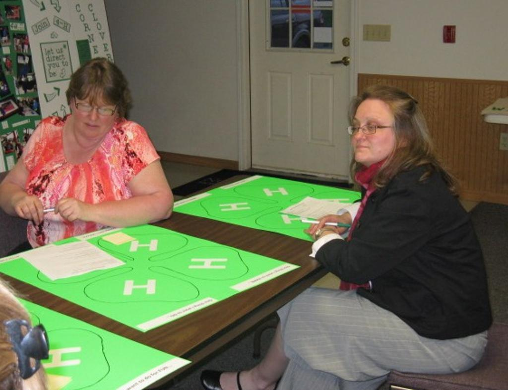Lori and Leslie participate in a club planning activity