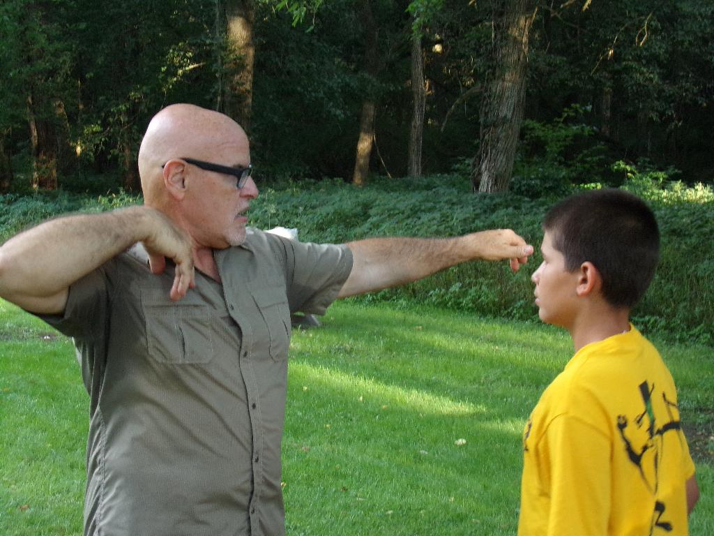 Instructors demonstrate technique