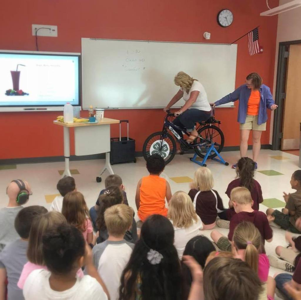 Mrs. Murphy received loud cheers while cycling and blending together our Triple Berry Smoothies.
