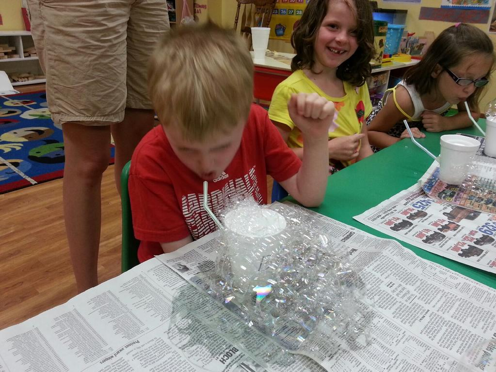 What are we going to do with all of these bubbles?  Having fun at a summer workshop in Macon County