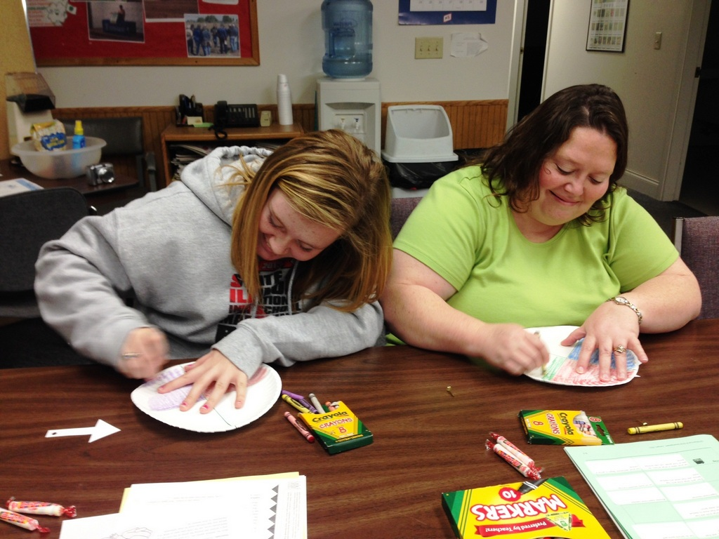 "Lorinda & Julia work on coloring their ""exercise spinners"""
