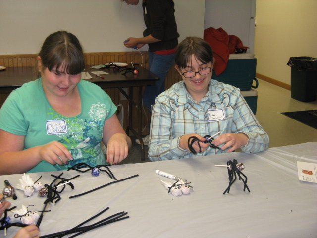 "Ashley and Hannah work on making ""spiders"""