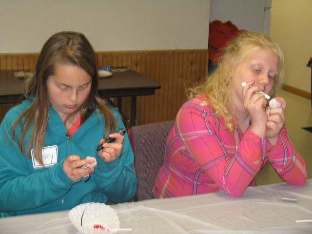 """Lexy and Kathryn work on their Tootsie Pop """"ghosts"""""""