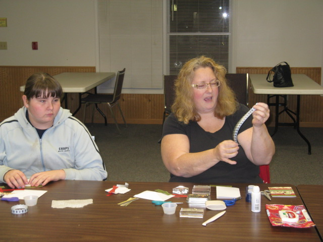 Amy Bailey, instructor, demonstrates card techniques