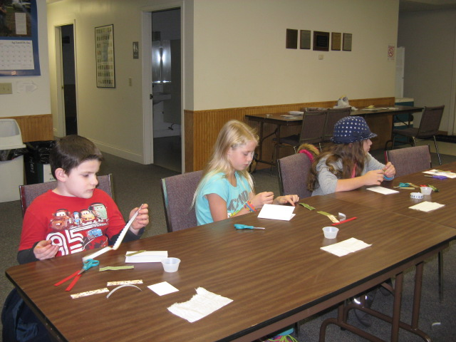 Joseph, Sierra and Rachel work on cards