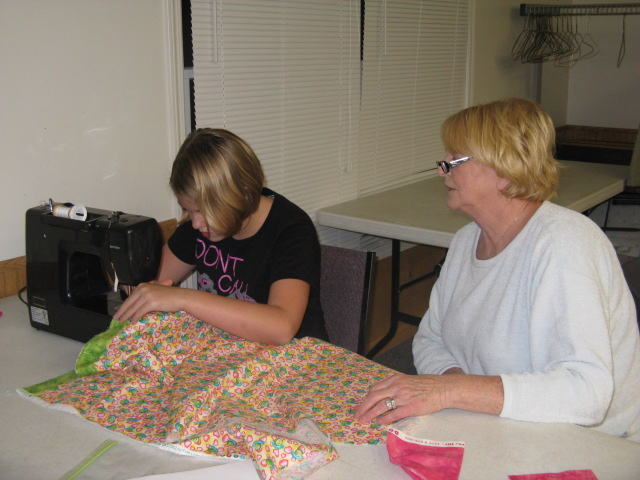 Devyn sewing with Melinda