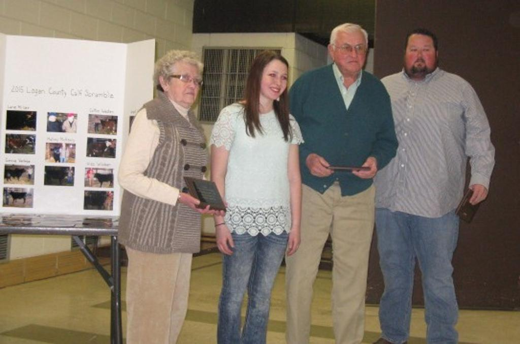 Plaques are presented to last years breeder and sponsors of the 2014 Champion Scramble Steer