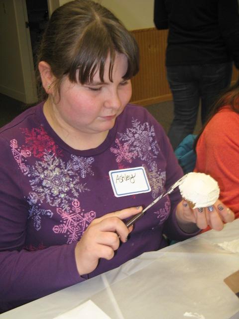 Ashley icing her cupcake