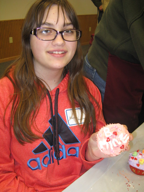 Hannah with her favorite cupcake