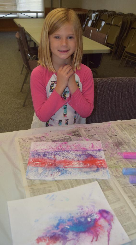 """Addy with her """"rain splatter"""" chalk art."""