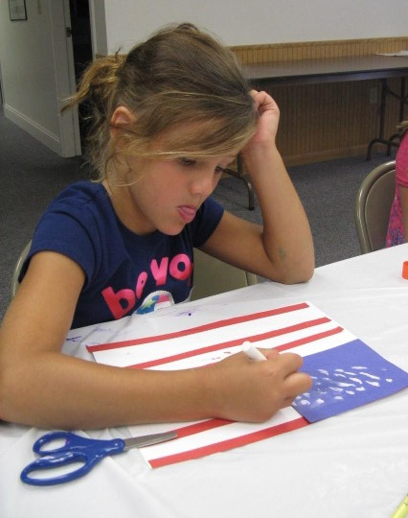 Alayna works on her flag project