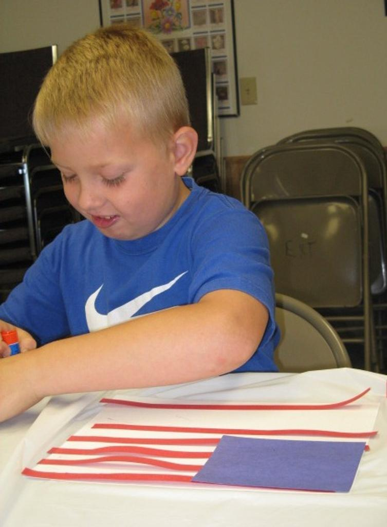 Alex works on his flag