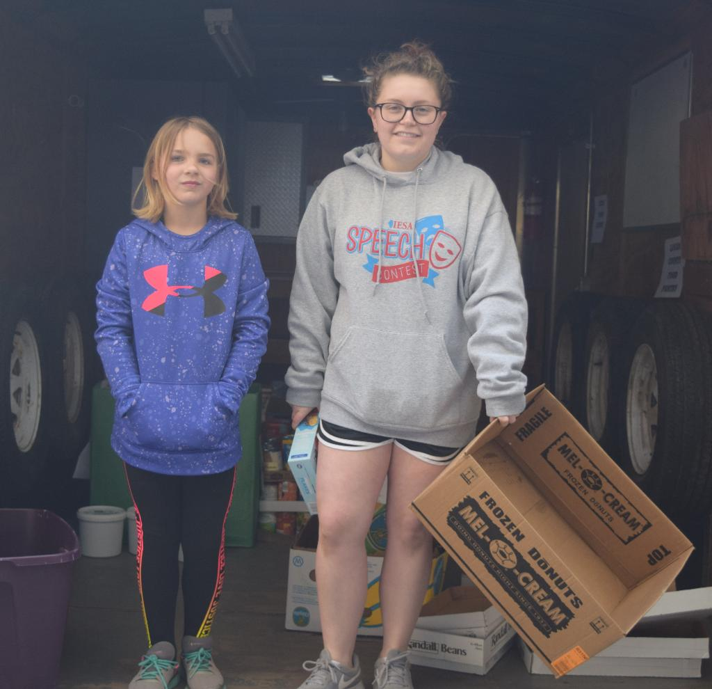 Logan youth worked in organizing donations in the trailer provided by Monsanto/Illiopolis