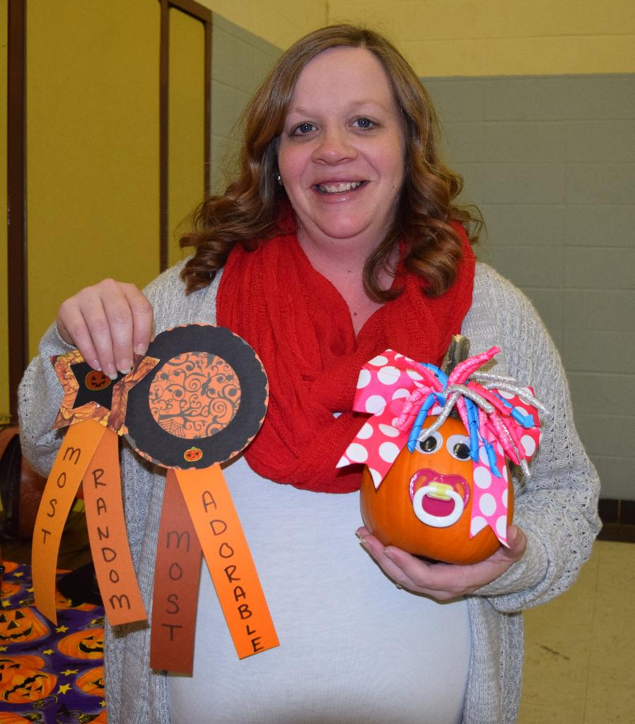 "Amanda and her ""Most adorable"" and ""Most random"" prize winning ""baby"" pumpkin"