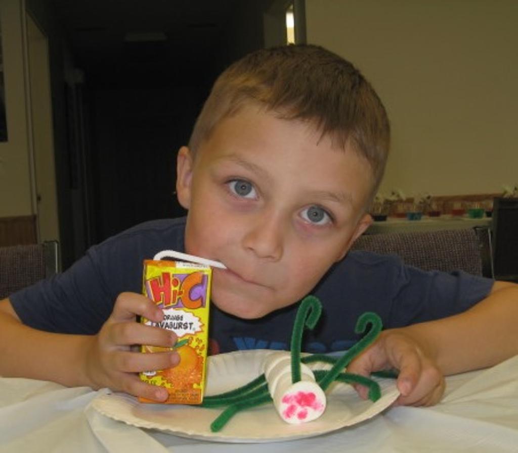"Jaxon with his edible ""ant"""