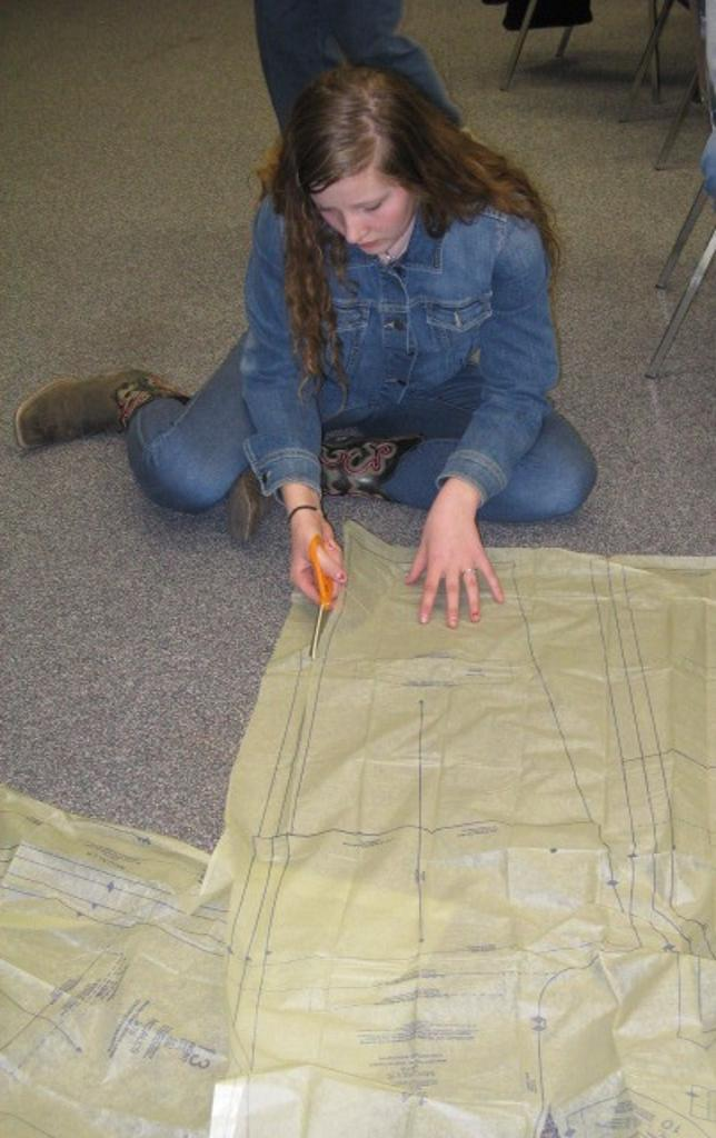 Ariana works on cutting her pattern