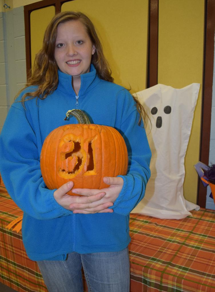 Pumpkin decorating contest overall WINNER!  Ariana & Oct 31 carved pumpkin.  Lighted ghost was prize