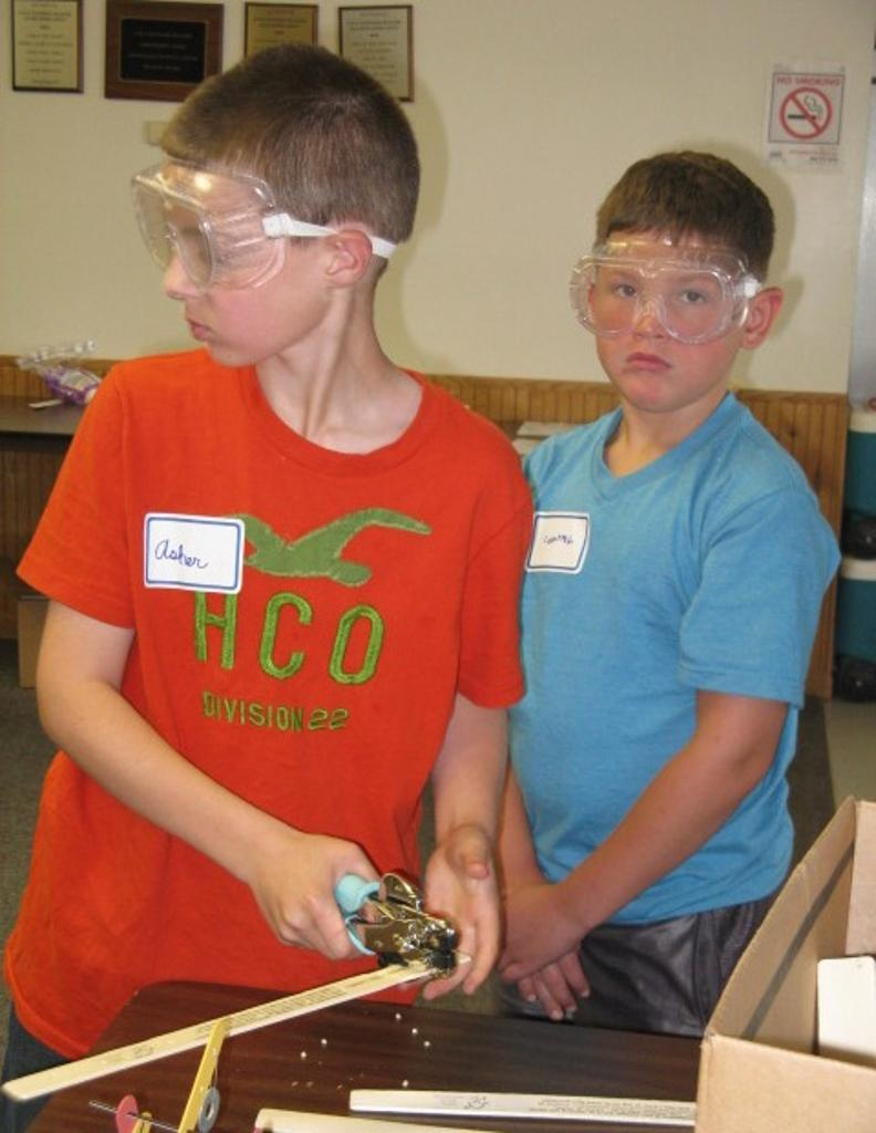 Asher and Cameron prepare parts for their catapults