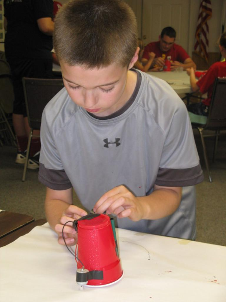 Asher works on can can robot