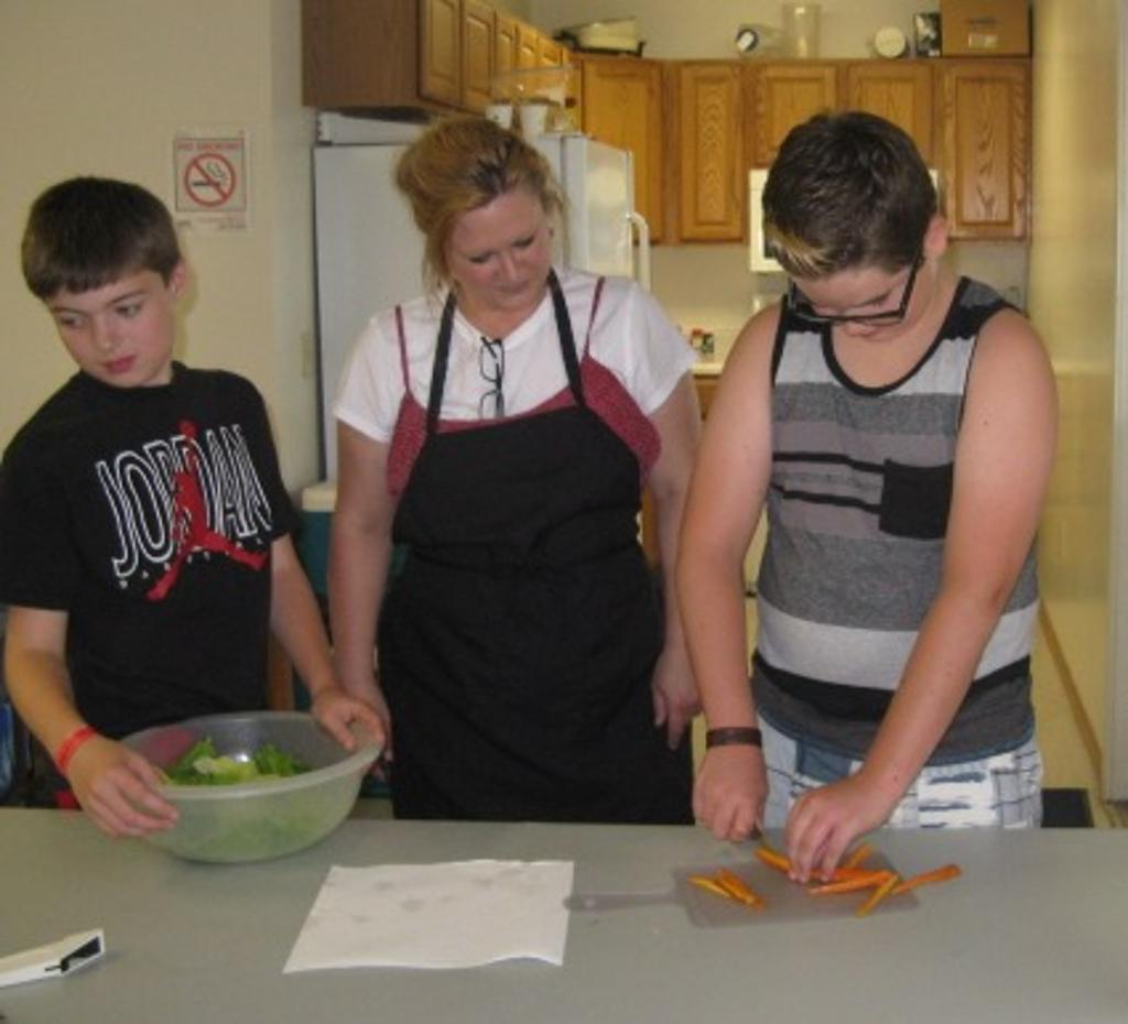 Murphy gets instruction on how to julienne carrots on Japanese Day