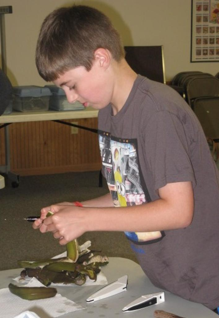 Asher works on bananas for the green banana dish on Tanzanian Day