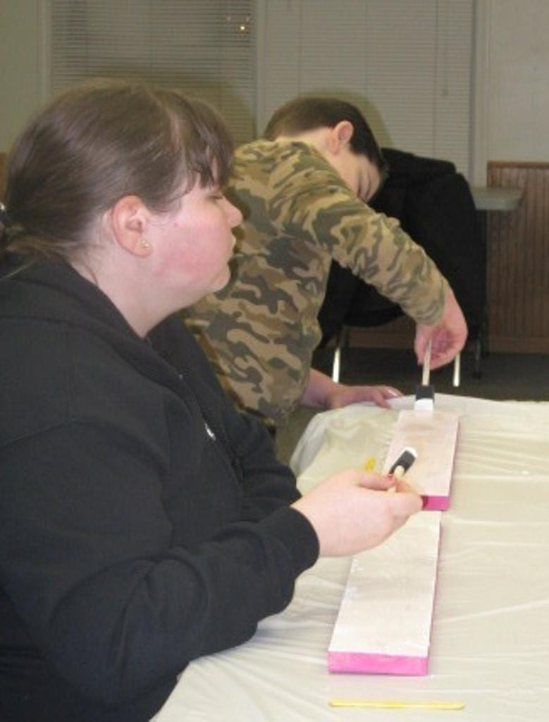 Ashley & Joseph work on painting their valentine project