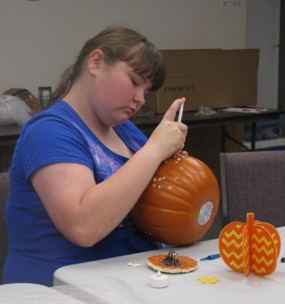 Ashley works on her pumpkin.