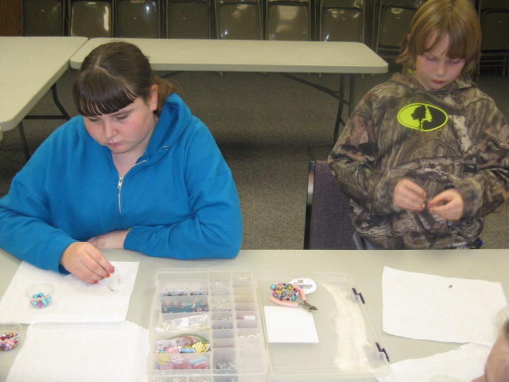 Ashley & Wyatt examine bead choices