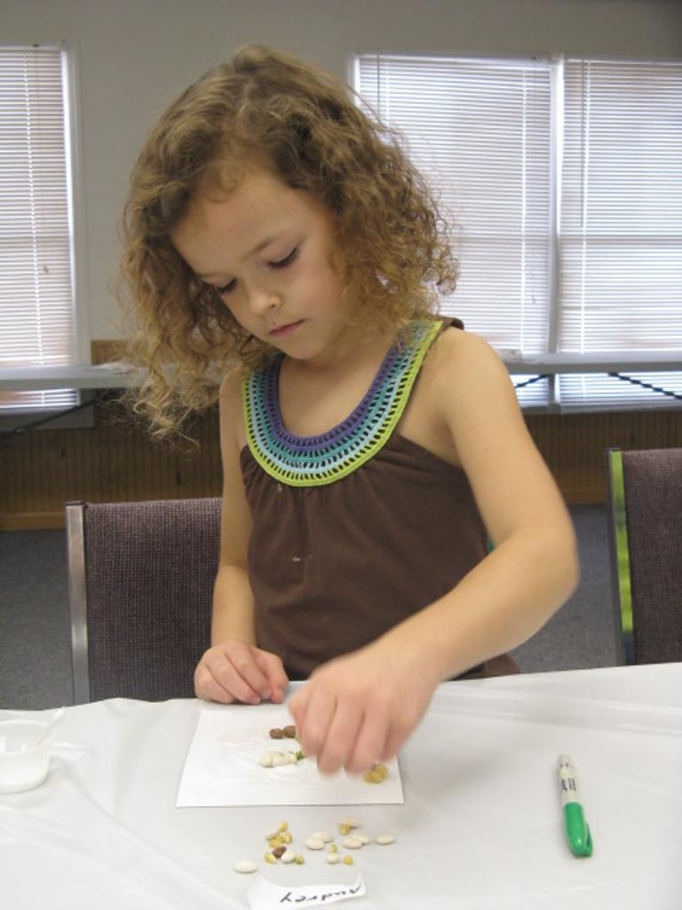 Audrey works on her seed picture