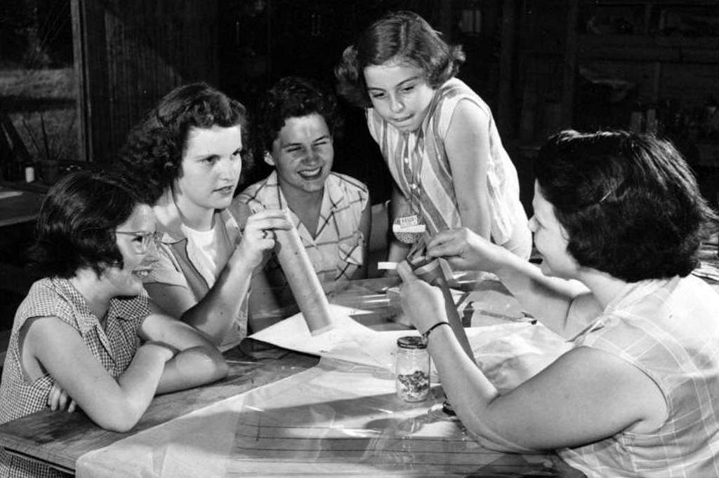 Girls making crafts.