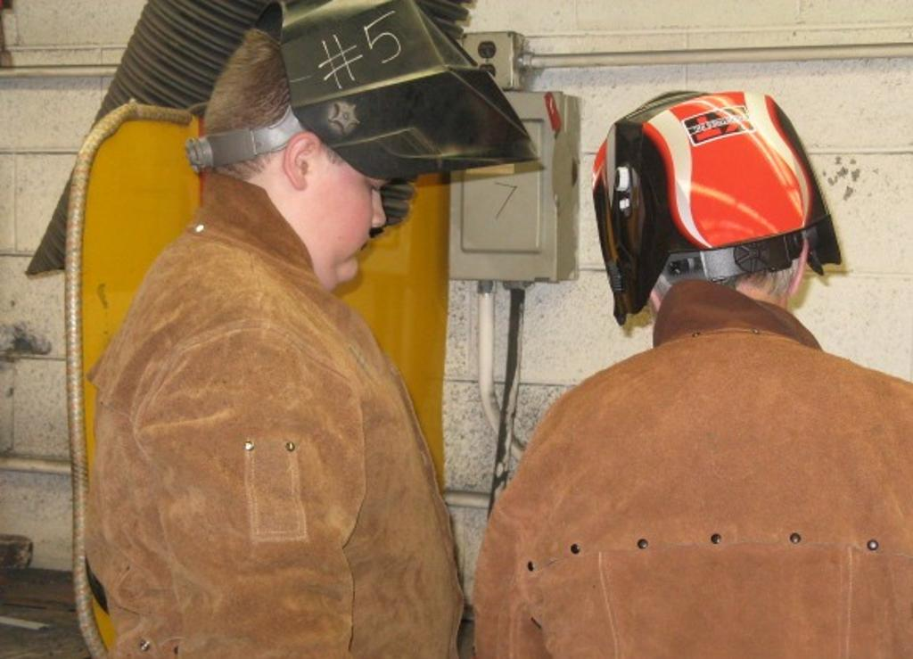 Bryson receives instruction on welding