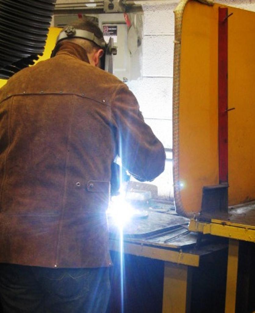 Bryson practices welding