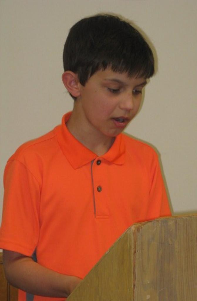 Caleb gives his Oral Interpretation presentation