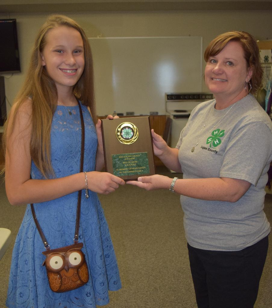 Caroline was selected 2016 Top Foods Exhibitor and received plaque from Stacie Skelton, Foods Supt.