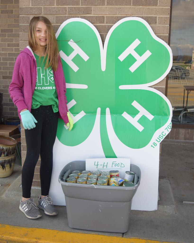 Another Logan 4-H'er who braved the early morning wind to help out!