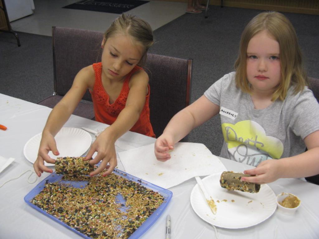Celia and Mackenzie make bird feeders