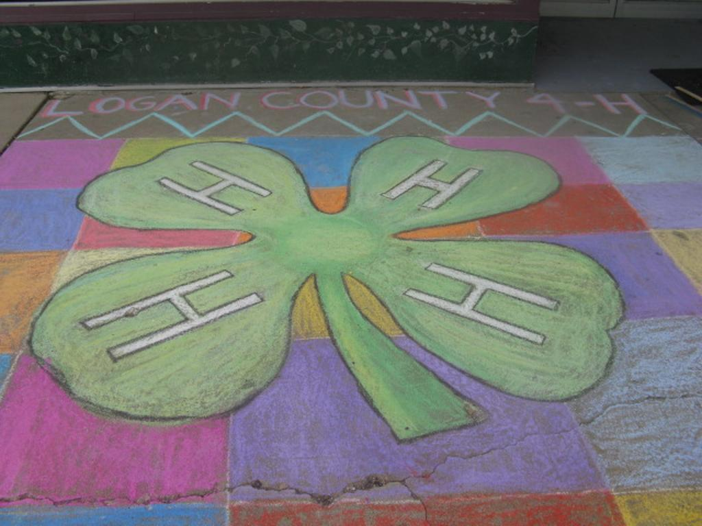 A closeup of the clover and heading of the chalk art square
