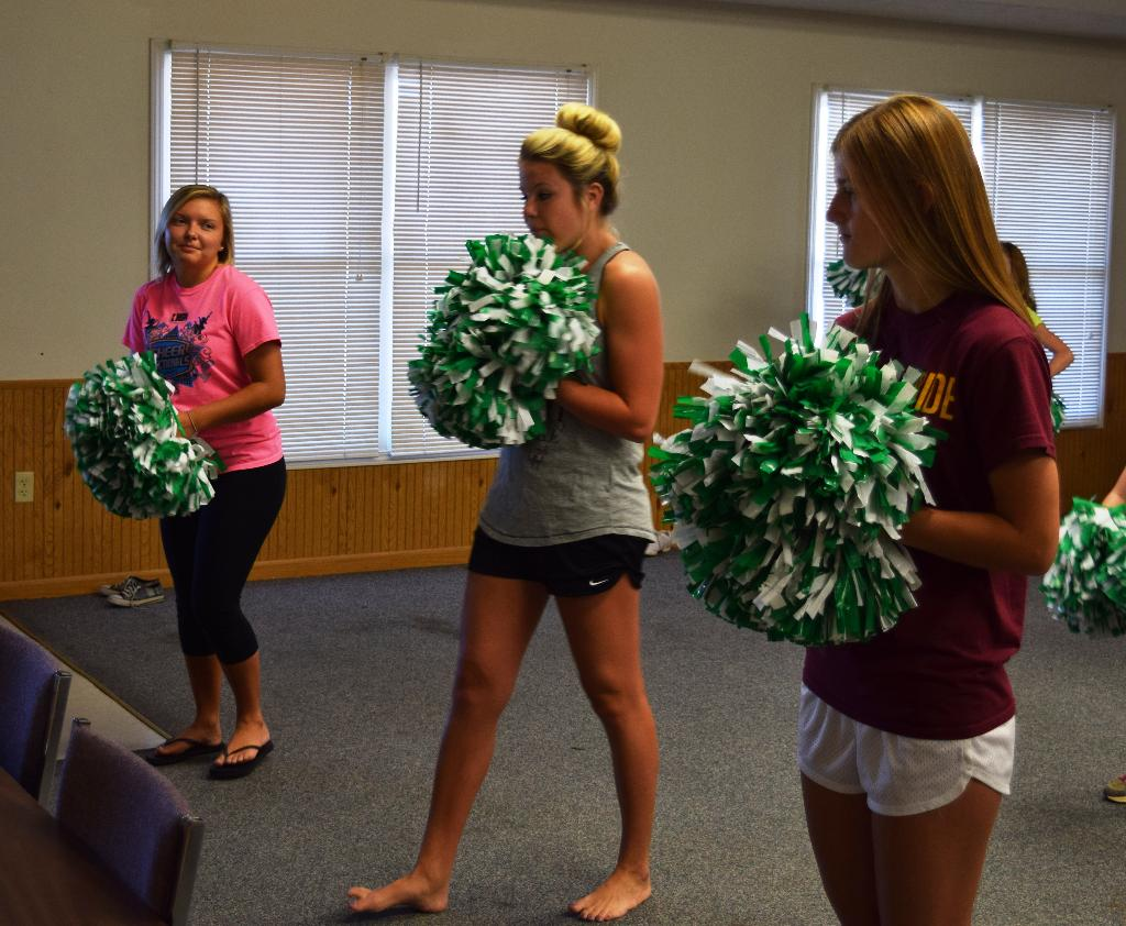More instruction from the Cheer Club leaders