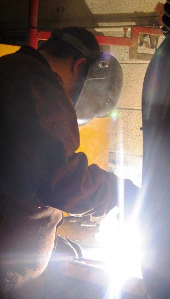 CJ works on welding