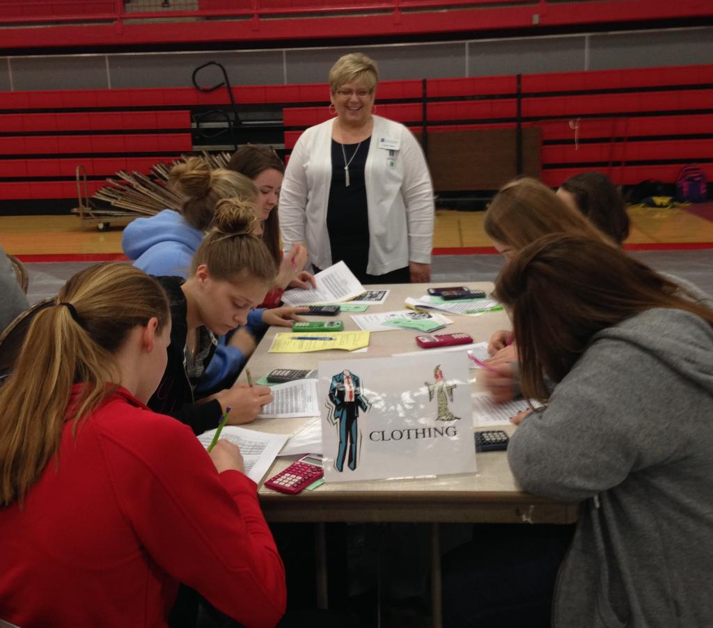 Connie Elliott of University of Illinois Extension teaching youth about clothing purchases