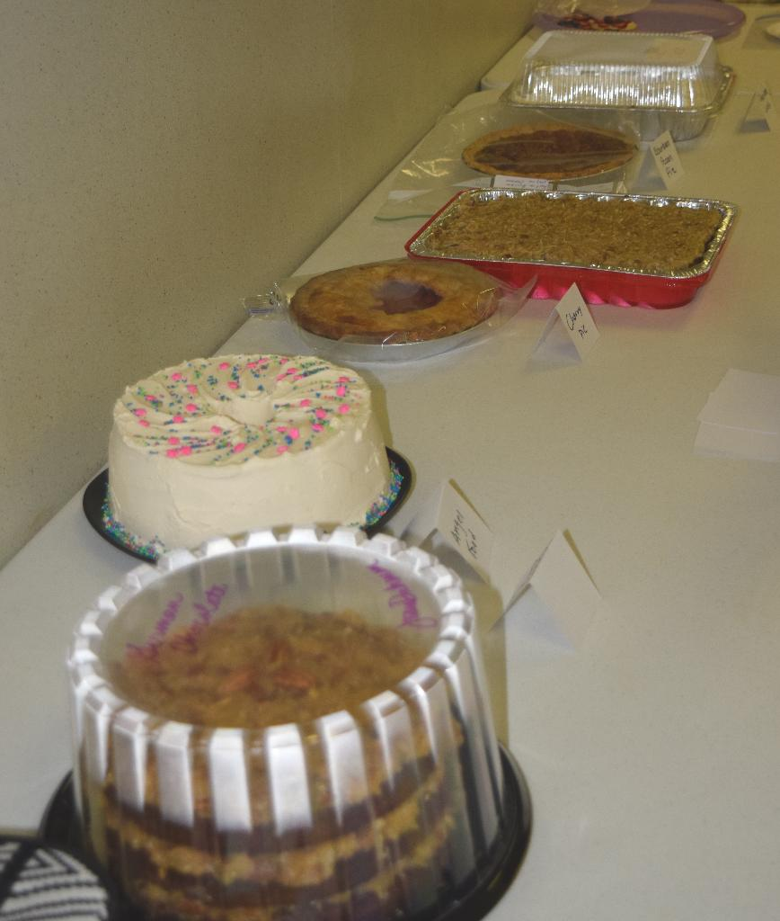 Cake/Pie/Sweets Auction table - seven yummy items were donated!