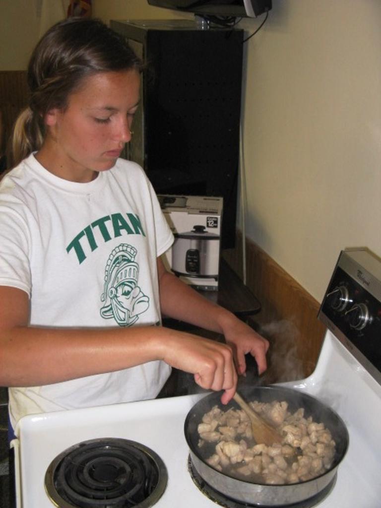 Diane cooks chicken for egg rolls on Japanese Day