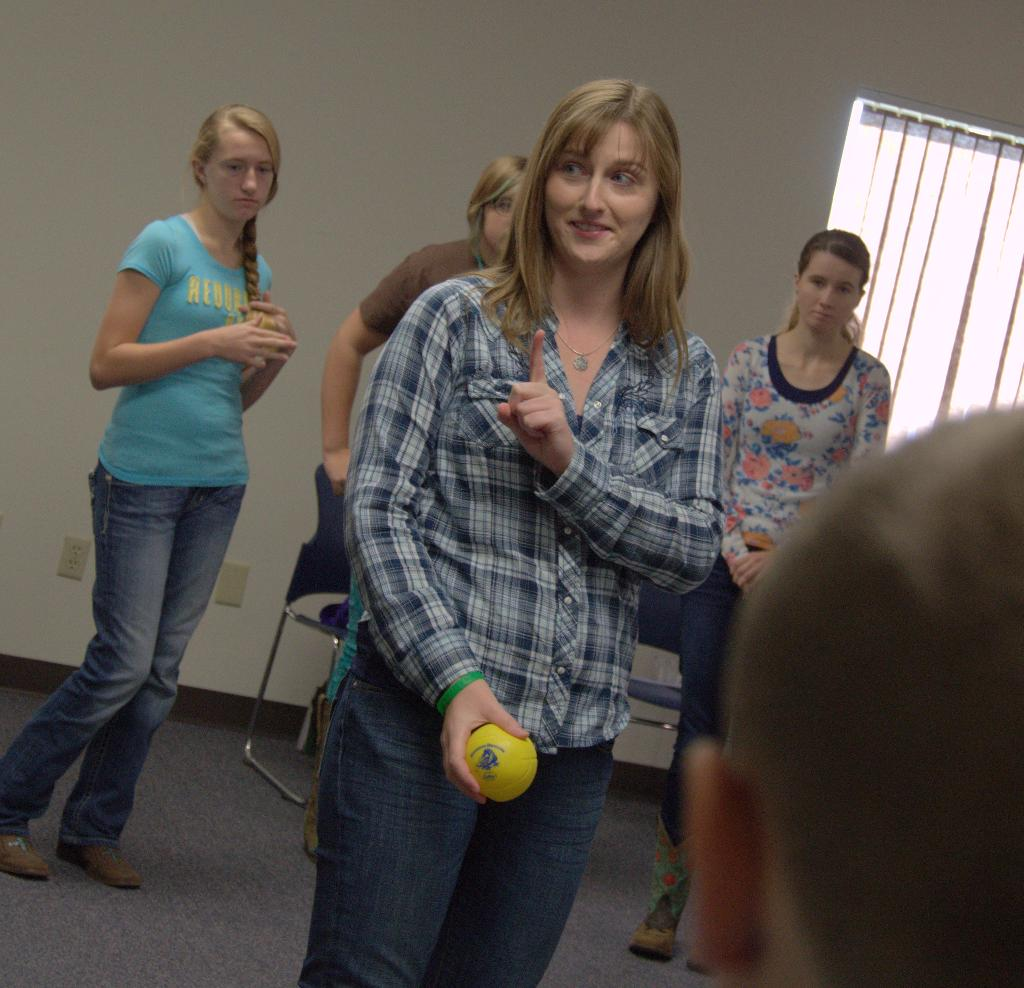 Volunteer and 4-H Alum Rebecca Luke leads Icebreakers and Team-Building