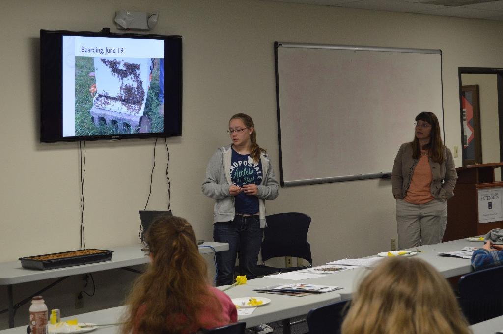 4-H Member explains how her hive operates and how she cares for the bees.
