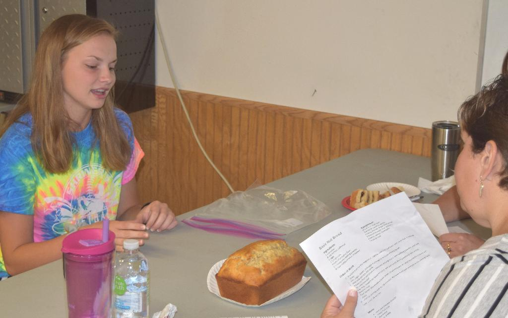 Emily being judged with her bread exhibit