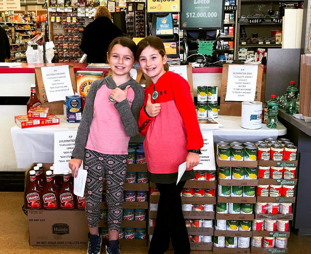 Menard county enthusiastic youth at the Food Drive table in County Market.