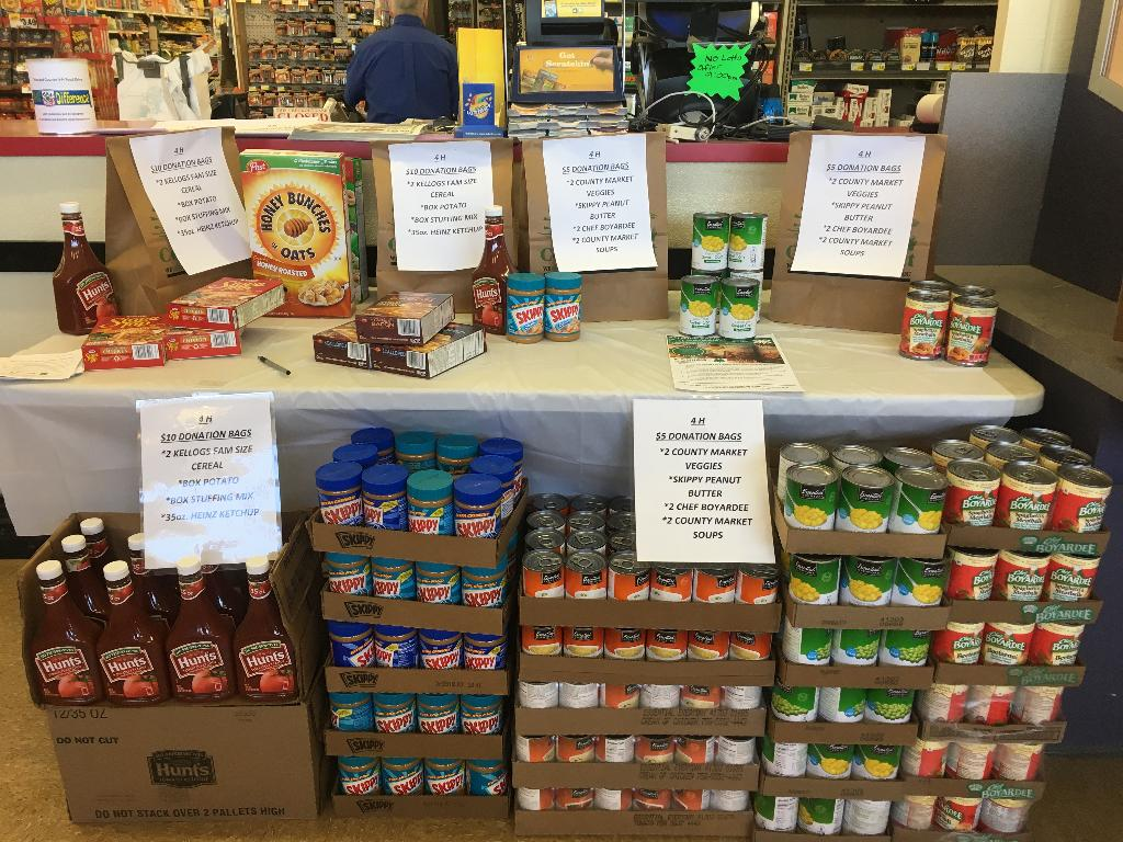 Display inside County Market for Menard Food Drive.