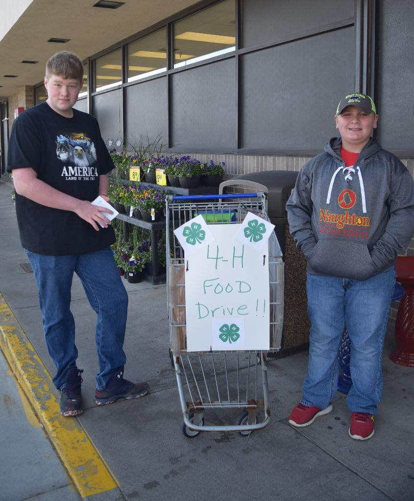 Logan 4-H members promote the Food Drive outside of Kroger!