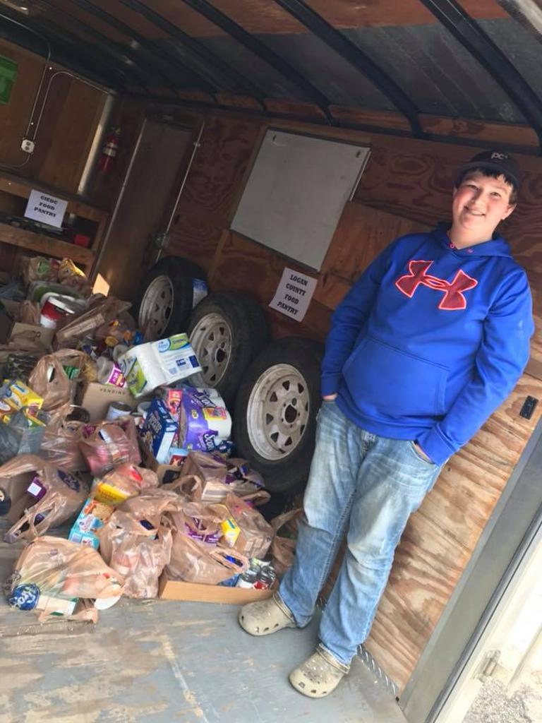 Logan 4-H member assisting with delivering donations to local food panties in Logan County.