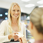Woman purchasing with credit card